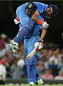 Suresh Raina of India and Yuvraj Singh of India celebrate victory in the International Twenty20 match between Australia and India at Sydney Cricket...