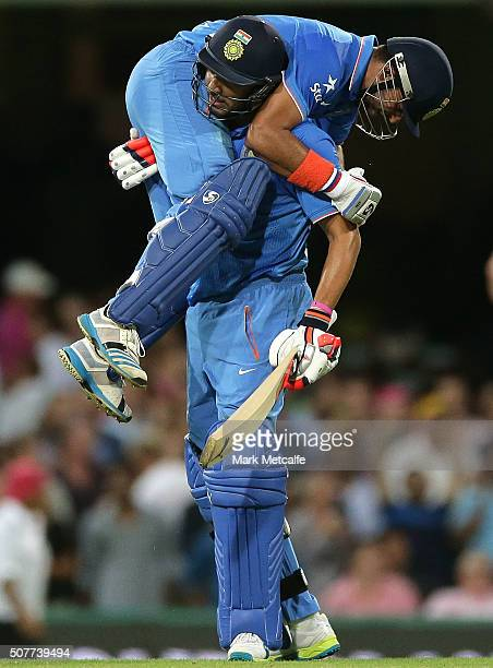 Suresh Raina of India and Yuvraj Singh of India celebrate victory in the International Twenty20 match between Australia and India at Sydney Cricket...