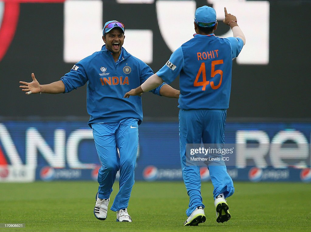 <a gi-track='captionPersonalityLinkClicked' href=/galleries/search?phrase=Suresh+Raina&family=editorial&specificpeople=542210 ng-click='$event.stopPropagation()'>Suresh Raina</a> of India celebrates catching Kusal Perera of Sri Lanka with <a gi-track='captionPersonalityLinkClicked' href=/galleries/search?phrase=Rohit+Sharma&family=editorial&specificpeople=815520 ng-click='$event.stopPropagation()'>Rohit Sharma</a> during the ICC Champions Trophy Semi Final match between India and Sri Lanka at SWALEC Stadium on June 20, 2013 in Cardiff, Wales.