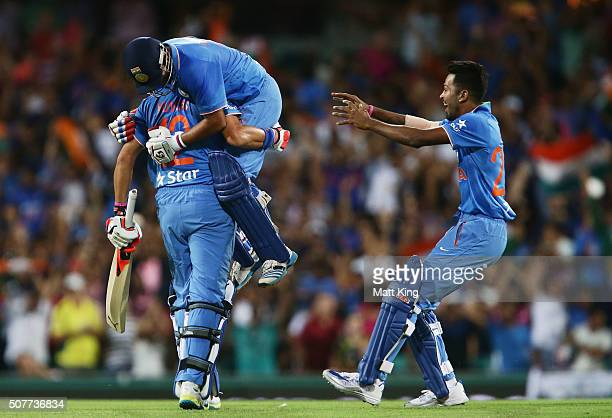Suresh Raina of India celebrates hitting the winning runs on the last ball of the match with Yuvraj Singh of India during the International Twenty20...
