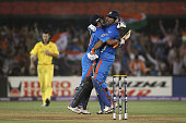 Suresh Raina of India celebrates the winning runs scored by Yuvraj Singh during the 2011 ICC World Cup QuarterFinal match between Australia and India...