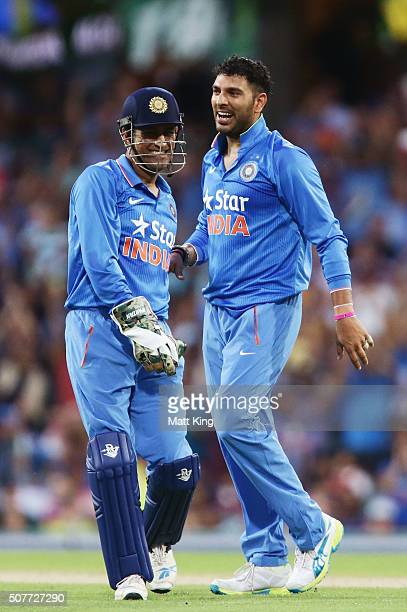 Suresh Raina of India celebrates with MS Dhoni of India after taking the wicket of Glenn Maxwell of Australia during the International Twenty20 match...