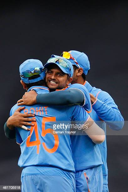 Suresh Raina of India embraces Rohit Sharma after taking a catch to dismiss David Warner of Australia during the One Day International match between...