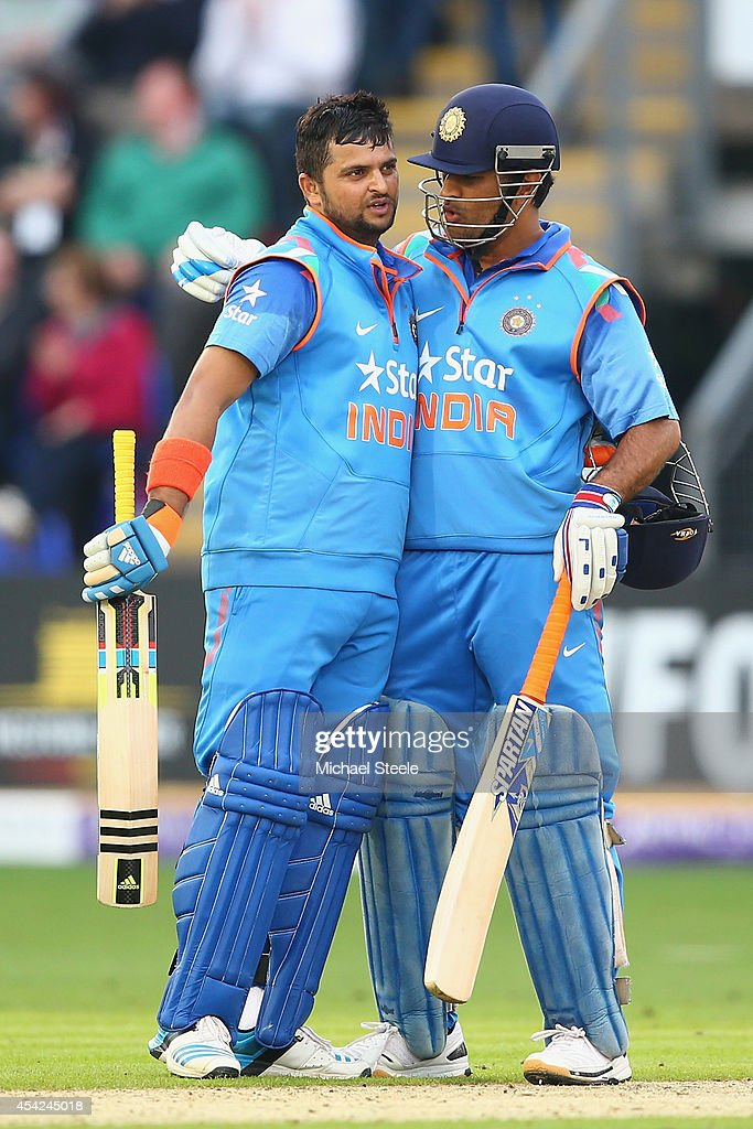 <a gi-track='captionPersonalityLinkClicked' href=/galleries/search?phrase=Suresh+Raina&family=editorial&specificpeople=542210 ng-click='$event.stopPropagation()'>Suresh Raina</a> (L) of India is congratulated by capatin MS Dhoni (R) after reaching his century during the second Royal London One-Day Series match between England and India at the SWALEC Stadium on August 27, 2014 in Cardiff, Wales.