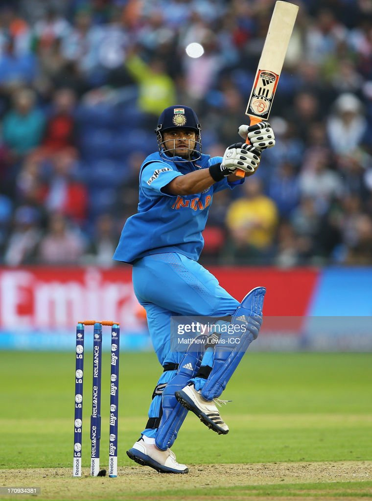 <a gi-track='captionPersonalityLinkClicked' href=/galleries/search?phrase=Suresh+Raina&family=editorial&specificpeople=542210 ng-click='$event.stopPropagation()'>Suresh Raina</a> of India pulls the ball towards the boundary during the ICC Champions Trophy Semi Final match between India and Sri Lanka at SWALEC Stadium on June 20, 2013 in Cardiff, Wales.