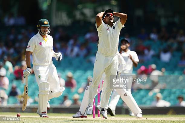 Suresh Raina of India reacts after wicketkeeper Wriddhiman Saha misses a run out chance on Shane Watson of Australia during day four of the Fourth...