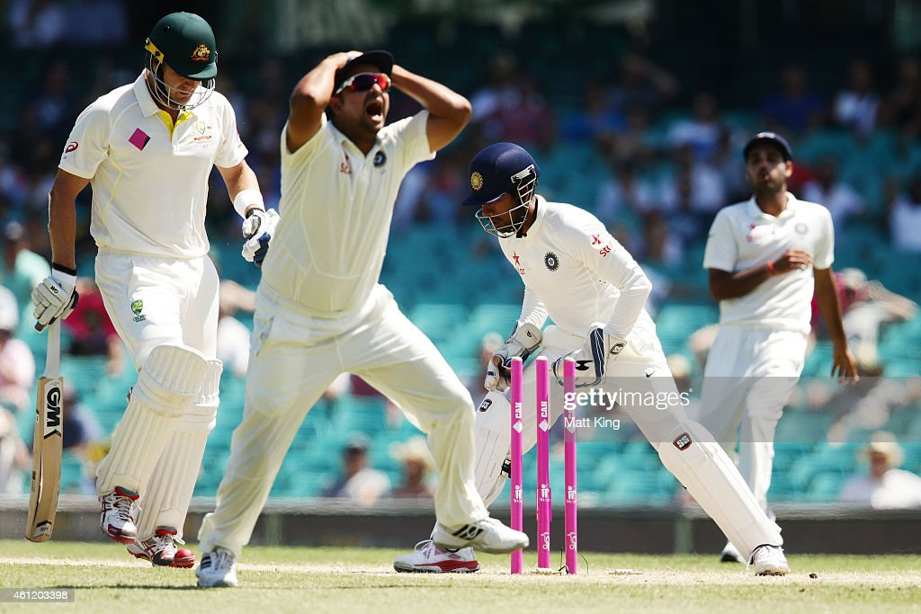 <a gi-track='captionPersonalityLinkClicked' href=/galleries/search?phrase=Suresh+Raina&family=editorial&specificpeople=542210 ng-click='$event.stopPropagation()'>Suresh Raina</a> of India reacts after wicketkeeper <a gi-track='captionPersonalityLinkClicked' href=/galleries/search?phrase=Wriddhiman+Saha&family=editorial&specificpeople=5834850 ng-click='$event.stopPropagation()'>Wriddhiman Saha</a> misses a run out chance on <a gi-track='captionPersonalityLinkClicked' href=/galleries/search?phrase=Shane+Watson+-+Cricket+Player&family=editorial&specificpeople=171874 ng-click='$event.stopPropagation()'>Shane Watson</a> of Australia during day four of the Fourth Test match between Australia and India at Sydney Cricket Ground on January 9, 2015 in Sydney, Australia.