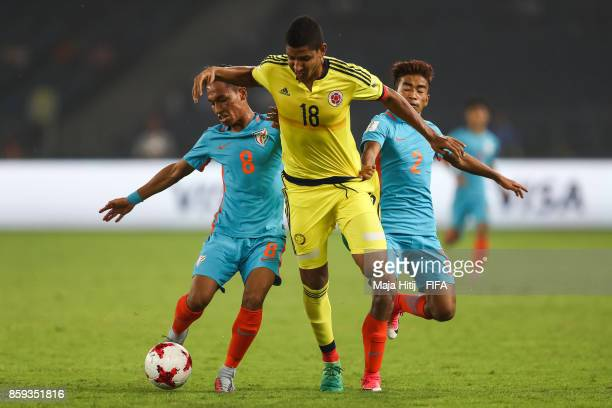 Suresh Wangjam of India Deyman Cortes of Colombia and Boris Thangjam of India battle for the ball during the FIFA U17 World Cup India 2017 group A...