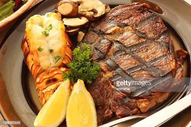 Surf and turf meal with lemon and steak
