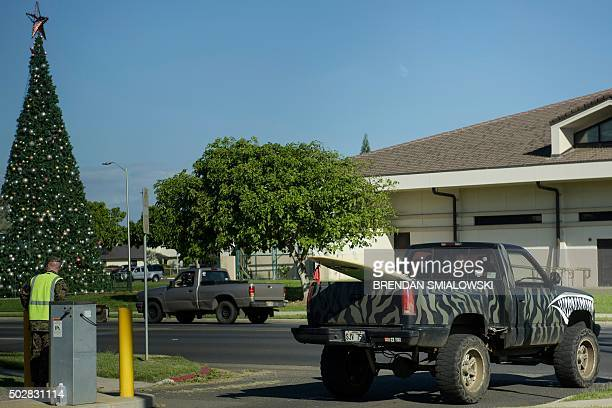 A surf board is seen in the bed of a Marine's pickup truck on Marine Corps Base Hawaii December 29 2015 in Kaneohe Bay Hawaii AFP PHOTO/BRENDAN...