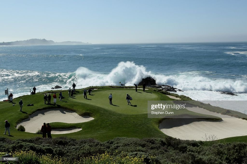 Surf crashes as a group plays the seventh hole during the final round of the ATT Pebble Beach National ProAm at Pebble Beach Golf Links on February...