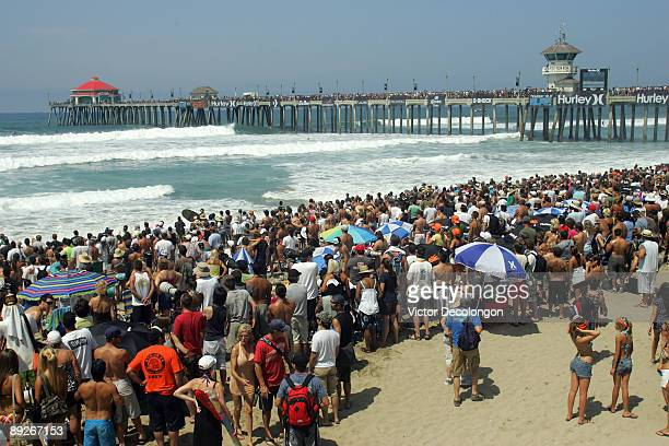 Surf fans watch the action during the 2009 Hurley US Open of Surfing on July 26 2009 in Huntington Beach California