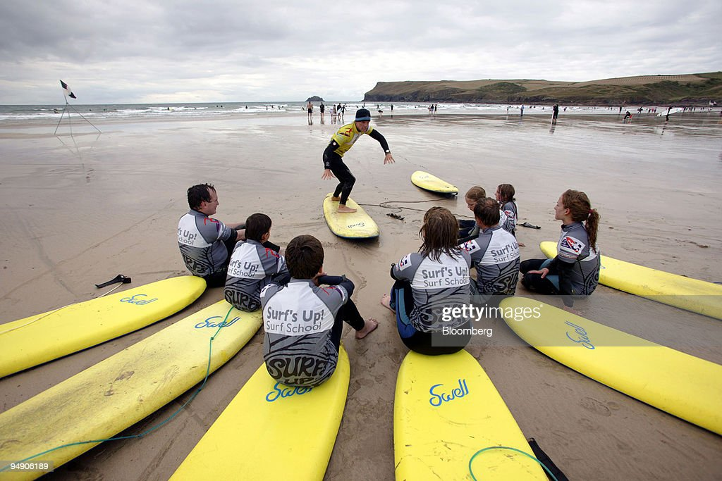 A surf instructor from the 'Surf'sUp' school holds a class on Polzeath beach North Cornwall Saturday July 30 2005 You don't need to haul the kids off...