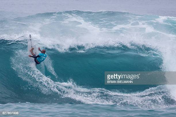 Surf legend Kelly Slater competes in the 2016 Vans World Cup surfing event at Sunset Beach Hawai on December 4 2016 The event was won by South...