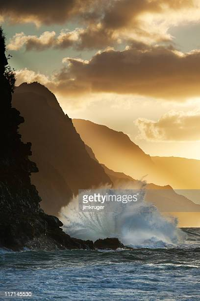 Surf smashing into Na Pali coast in Hawaii.