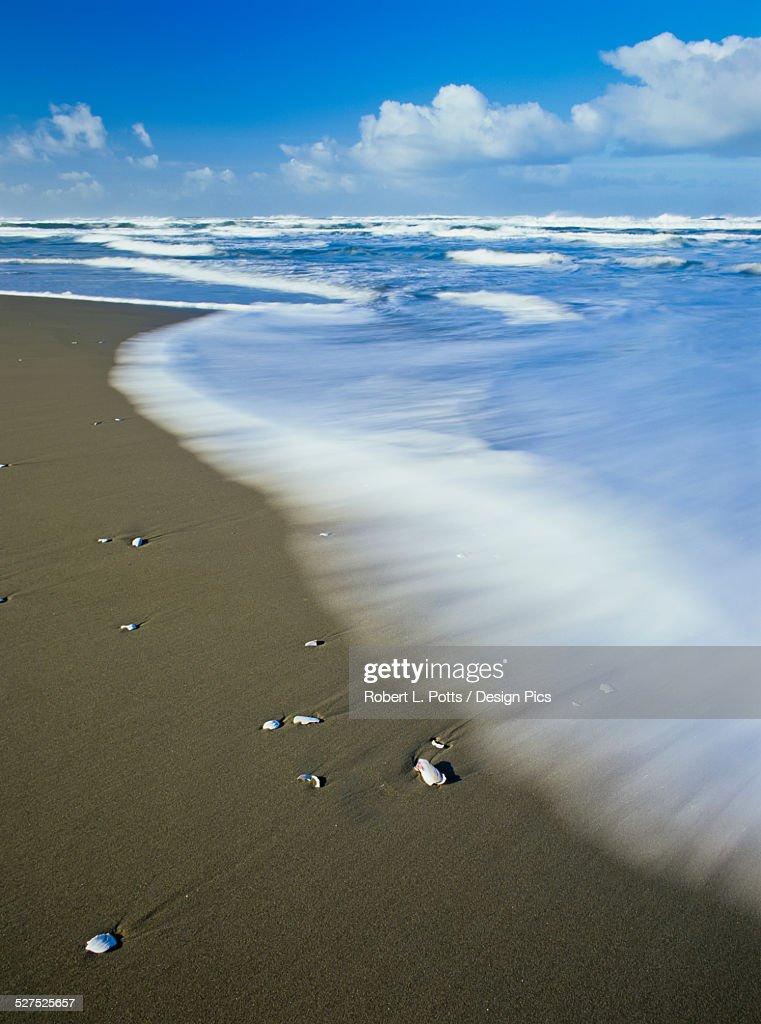Surf washes onto Umpqua Beach