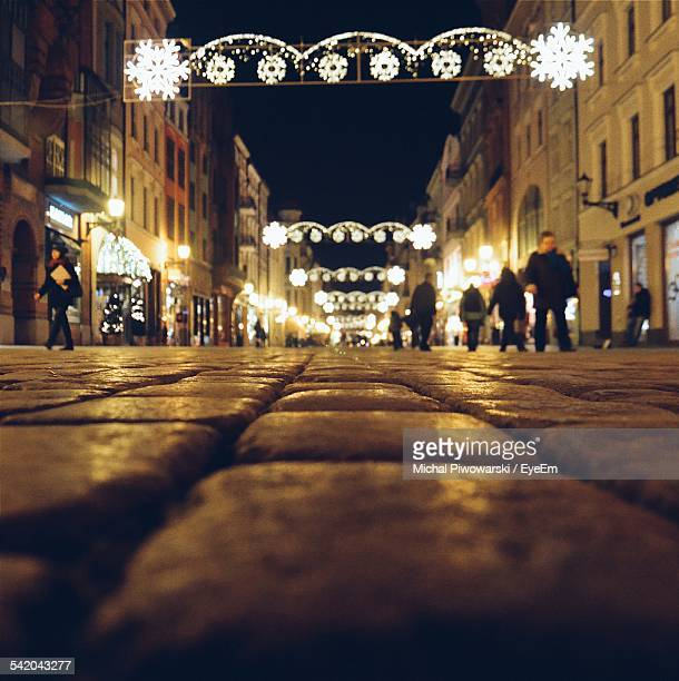 Surface Level Of Illuminated City Street During Christmas At Night