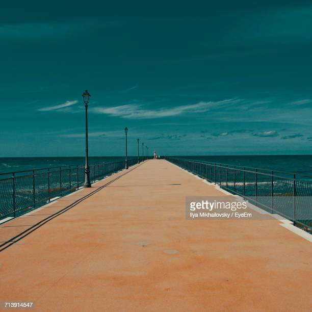 Surface Level Of Pier Leading To Calm Blue Sea