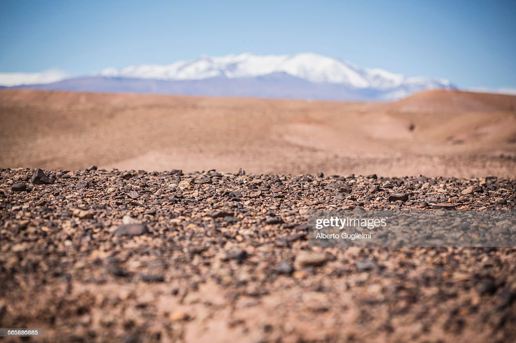 Surface level view of gravel field and remote desert