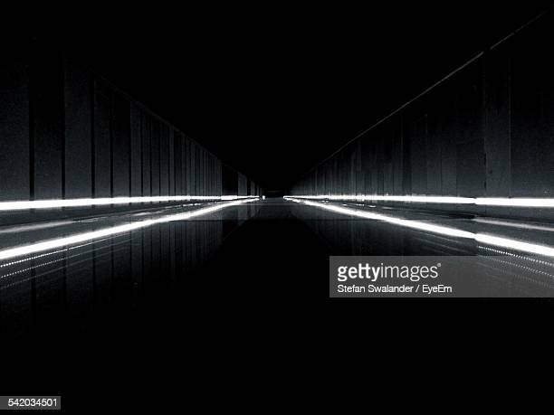 Surface Level View Of Illuminated Footbridge