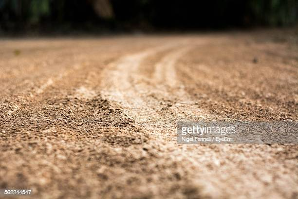 Surface Level View Of Tire Track On Road