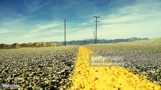 [Image: surface-level-view-of-yellow-road-markin...?s=170667a]
