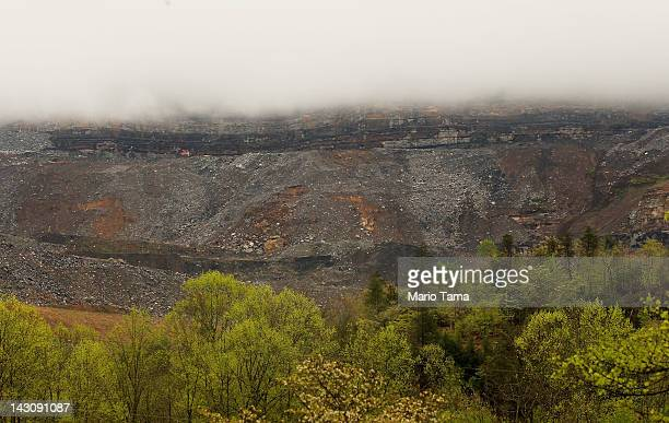 Surface mining operations are seen beneath low lying clouds in the Appalachian Mountains on April 18 2012 in Partridge Kentucky Some types of surface...