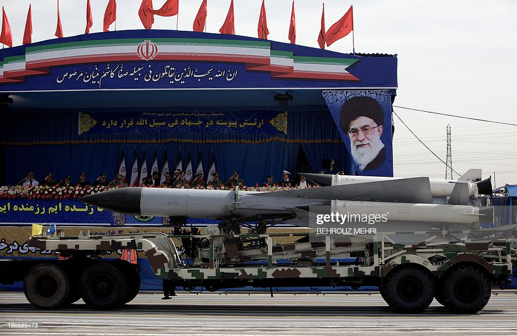 A S-200 surface-to-air missile is driven past the platform where President Mahmoud Ahmadinejad and other military officials are sitting during the Army Day parade in Tehran on April 18, 2013. The Iranian army 'alone' is able to destroy Israel, Tehran's regional arch foe, Islamic republic army commander general Ataollah Salehi said, on the sideline of the country's annual Army Day.