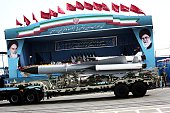 A S200 surfacetoair missile system is driven past Iranian military commanders during the Army Day parade in Tehran on April 18 2015 Russian President...