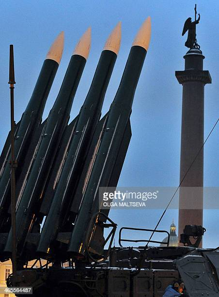 A surfacetoair missile system rises into the sky near the landmark Alexander's Column at an outdoor exhibition of WWIIera Red Army and modern Russian...