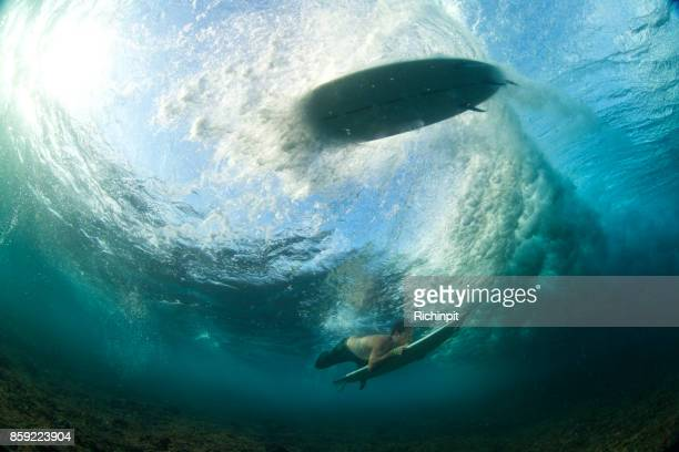 Surfboard above a duckdive
