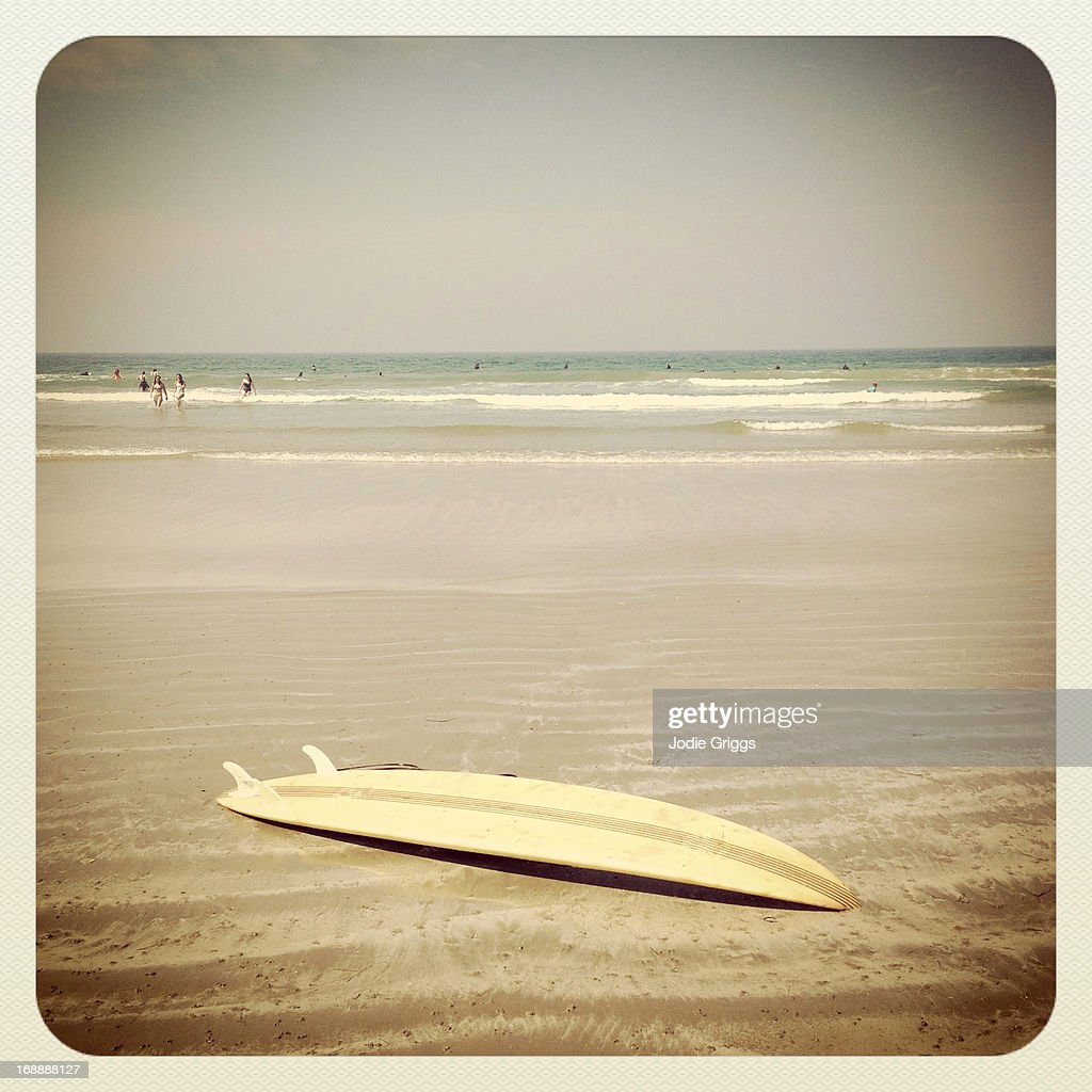 Surfboard Laying On The Sand At The Beach Stock Photo ...