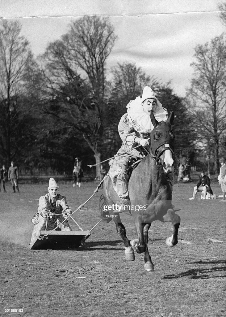 Surfboard rider in clown costume is pulled by a horseman Dress rehearsal of the Fifth Royal Inniskilling Dragoon Guard Berechurch Park / Colchester...