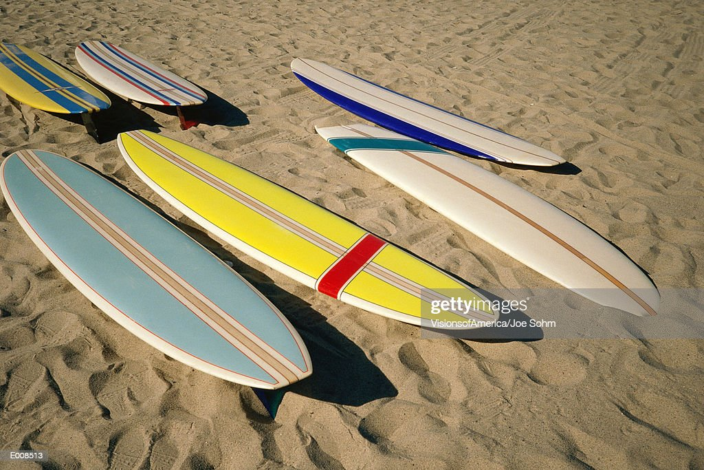 Surfboards lying on sand : Stock Photo