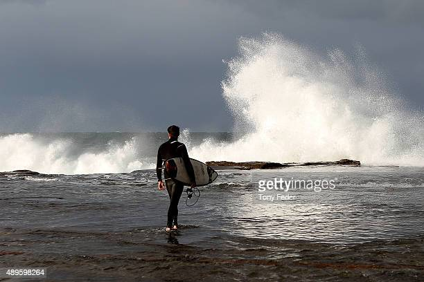A surfer about to enter the water at Terrigal on the New South Wales Central Coast on September 23 2015 in Sydney Australia The Bureau of Meteorology...