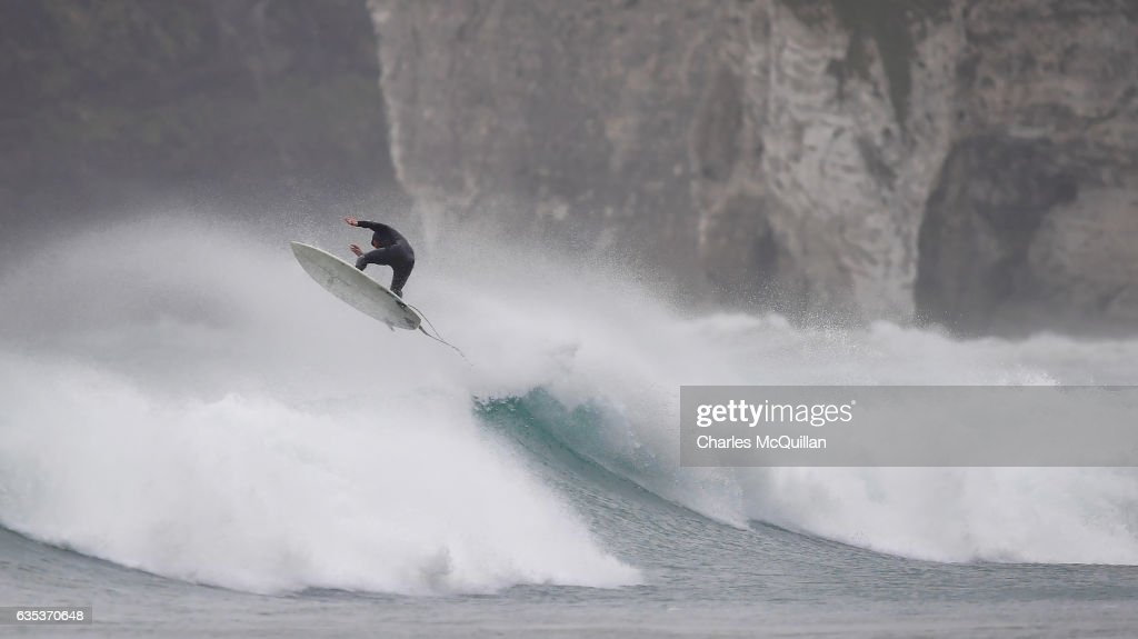 Surfer Al Mennie catching some serious air on a wave beneath Dunluce Castle on October 31, 2016 in Portrush, Northern Ireland.