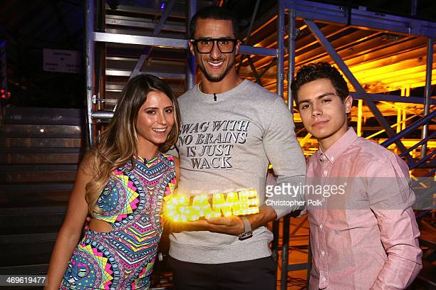 Surfer Anastasia Ashley cohost Colin Kaepernick with his I Got Swag award and actor Jake T Austin attend Cartoon Network's fourth annual Hall of Game...