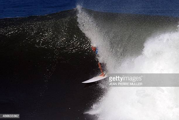 US surfer and 11 times world champion Kelly Slater competes in the waves of Hosségor during his qualification for the quarter finals of the...