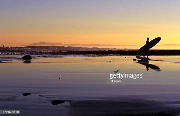 Surfer at Sunset in Santa Barbara, California