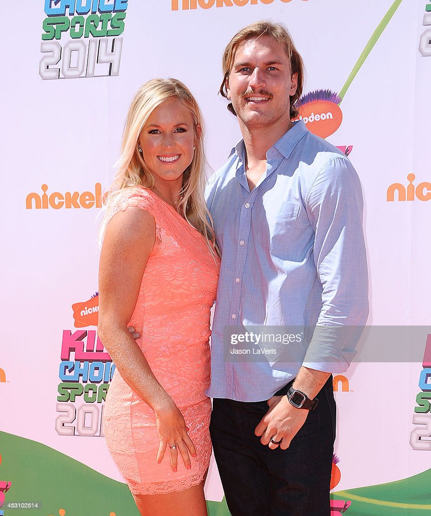 Surfer Bethany Hamilton and Adam Dirks attend the 2014 Nickelodeon Kids' Choice Sports Awards at Pauley Pavilion on July 17, 2014 in Los Angeles, California.