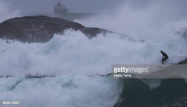 A surfer catches a wave during strong winter swells on the Atlantic Ocean on August 11 2017 in Rio de Janeiro Brazil Waves were measured as high as...