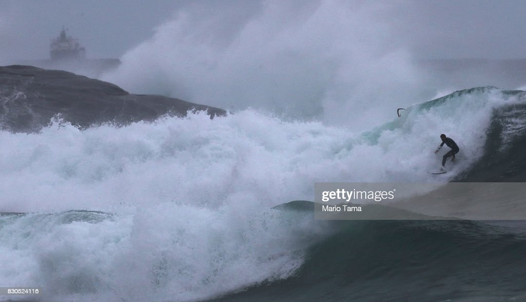 A surfer catches a wave during strong winter swells on the Atlantic Ocean on August 11, 2017 in Rio de Janeiro, Brazil. Waves were measured as high as thirteen feet in Rio today in the middle of Brazil's winter season. According to the Urban Climate Change Research Network (UCCRN), Rio's average temperature would rise around one degree Celsius between 2015 and 2020 along with a sea level rise of 14 cm. Changes in Rio's climate are projected to be the most dire of all cities in South America, according to UCCRN.