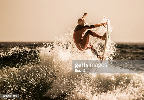 Surfer catching the best wave at sea.