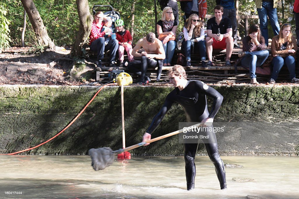Surfer cleans the Eisbach on October 20, 2012 in Munich, Germany.