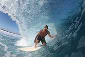 surfer close up on a wave