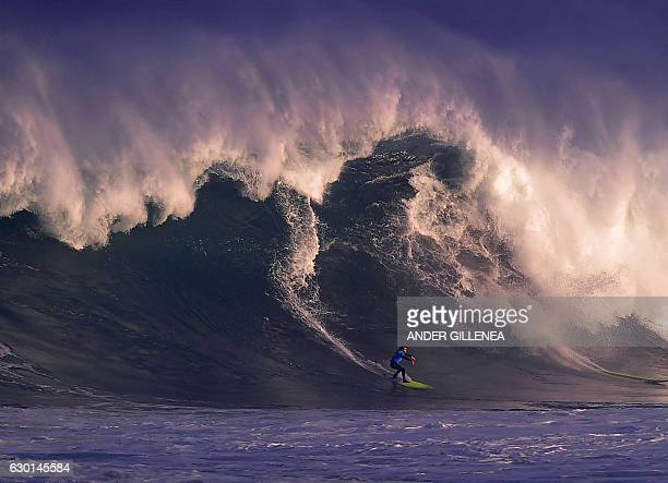 A surfer competes in 'La Vaca Gigante By Oakley' big wave surfing competition in the Northern Spanish city of Santander on December 17 2016 53...