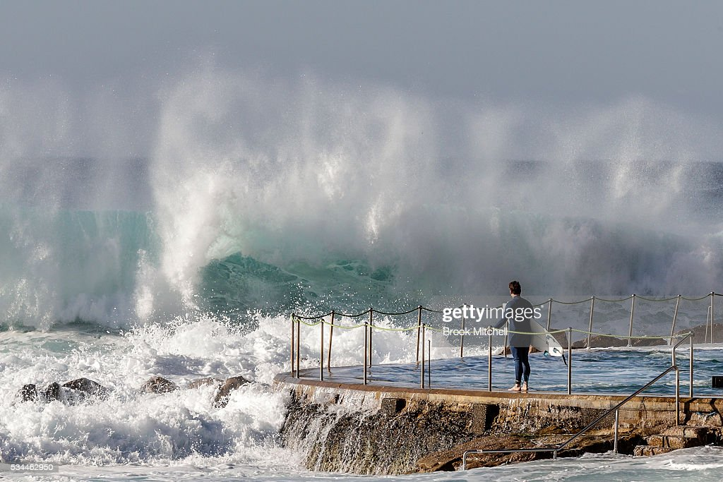 A surfer contemplates paddling out at Bronte Beach on May 25, 2016 in Sydney, Australia. All Sydney beaches were closed to swimmers today as large waves pounded the coast.