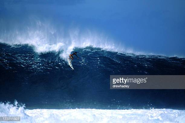 Surfer dropping in at big Pipeline, Hawaii