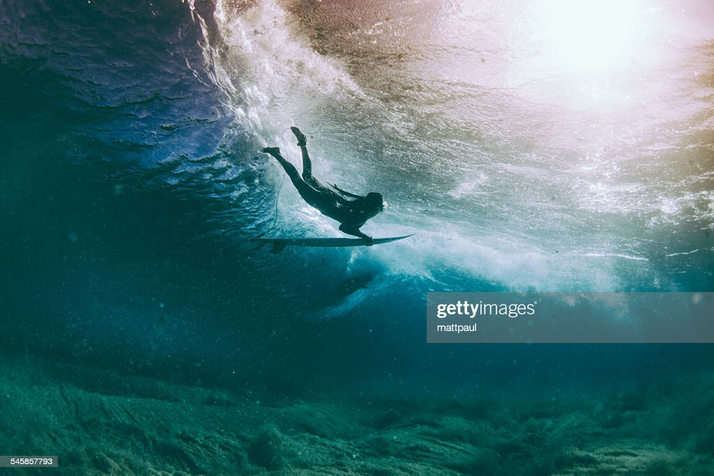 Surfer duck diving under a wave, Hawaii, America, USA : Stock Photo