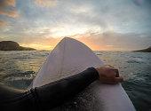 Surfer enjoying sunset (point of view)